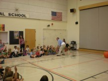Principal Matthew Carlson gaining support from his students in preparation for his sumo match-ups!